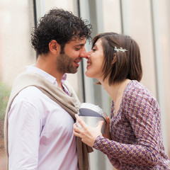 Romantic Young Couple with Gift for Her