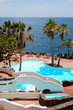 View on the beach, palms and swimming pool of luxury hotel, Tene