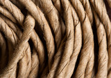 Hank of rope. Side view. Used in gardening. Closeup poster