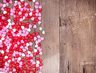 heart shape candy on wooden plank