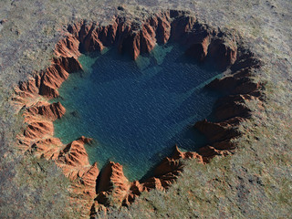 heart-shaped crater with a lake inside