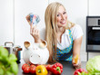 Woman in kitchen saves ready cash with cooking by herself