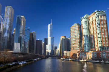 Chicago River with urban skyscrapers and riverwalk, IL, USA