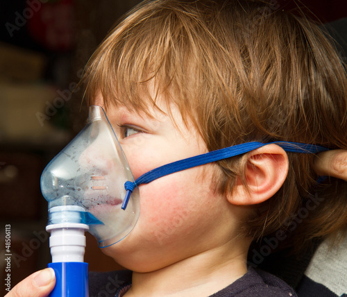 child taking respiratory, inhalation therapy.