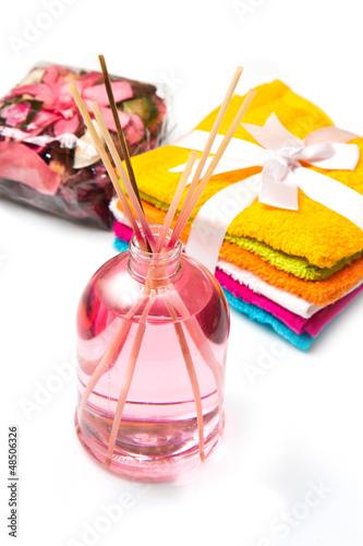 olio profumato e asciugamani