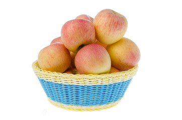 Basket full of apples isolated on white