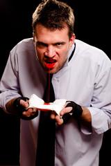 Businessman spitting blood