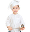 Cute little boy in chef's hat holding ladle.