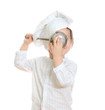Cute little boy in chef's hat holding ladle near face.