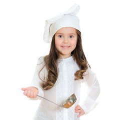 Pretty little girl in chef's hat holding ladle.