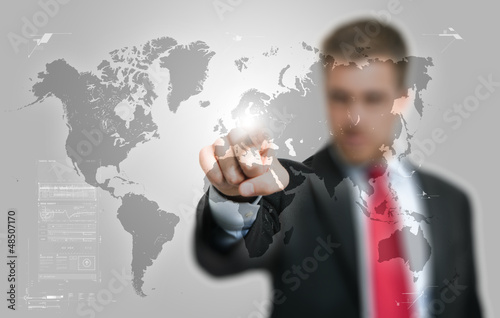 Businessman looking at a digital world map