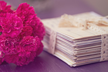 stack of old letters with roses