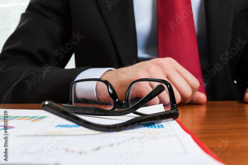 Eyeglasses on a business report
