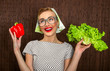 Funny woman cook holding salad and sweet pepper, close up