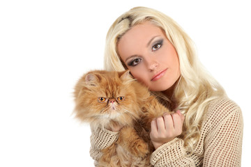 Young woman hugging a large soft red cat
