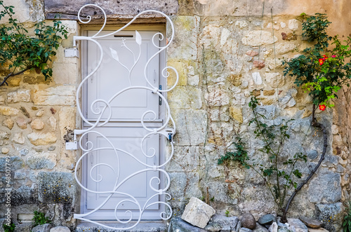 Provence white door with metal bars