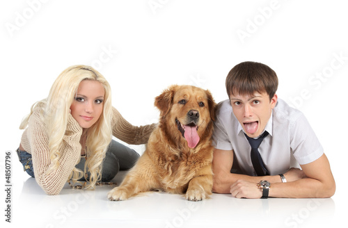 Couple with a dog lying on a white background