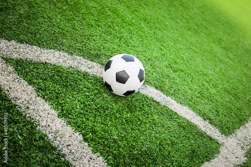 football on green field conner