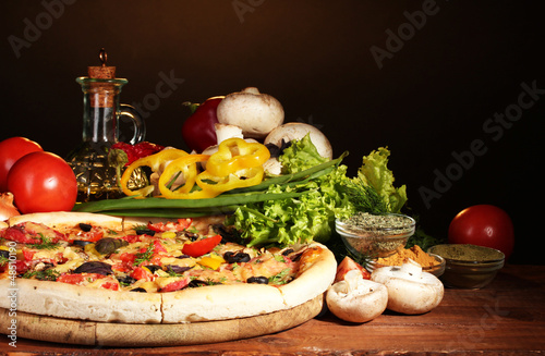 delicious pizza, vegetables and spices