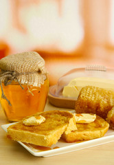 White bread toastwith honey on plate in cafe