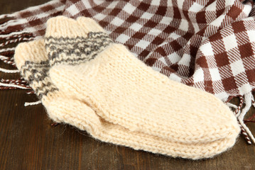 Warm knitted socks on wooden table close-up