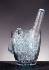 Glass ice bucket on grey  background