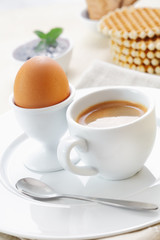 Boiled egg and coffee for breakfast