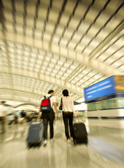 Passengers walk at the Beijing International Airport
