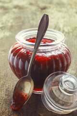 Fluted glass jar of strawberry jam