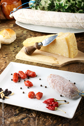 Spicy sausages, bread and cheese