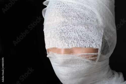 Portrait with bandaged face