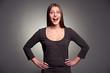 studio portrait of excited woman