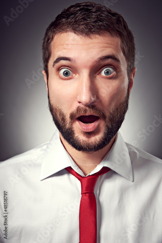 surprised man over grey background