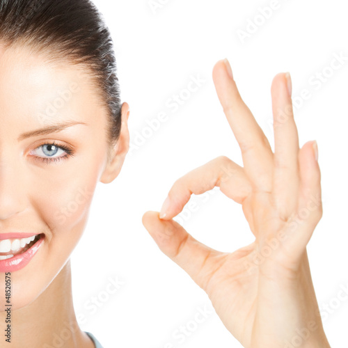 Happy smiling woman with okay gesture, isolated