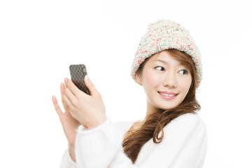 Beautiful asian woman using a cellular on white background