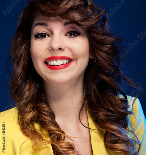 Expressive portrait of a beautiful happy young woman