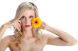 beautiful blond girl with gerber daisy flower on a white backgro