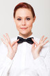 elegant young waitress holding on to bow tie
