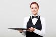 pretty waitress holding an empty tray