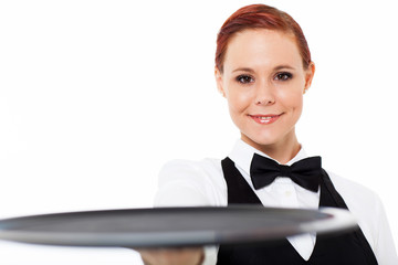 cute young waitress holding an empty tray on white