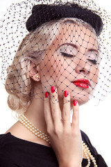 Blond Woman with bright make up and red nails in hat over white