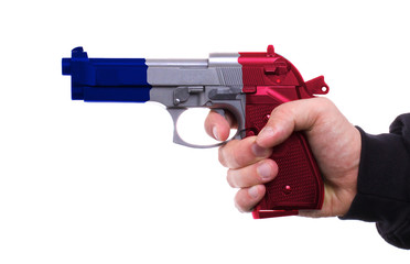 Pistol with french flag pattern in hand