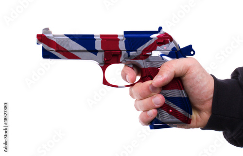 Pistol with UK flag pattern in hand