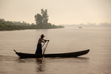 Myanmar man rowed across the river.