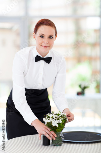 pretty young waitress working in modern restaurant