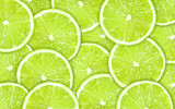 Close-up green background with lime slices