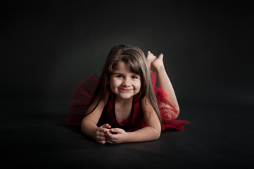 girl with red dress dancing