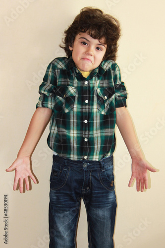 Studio portrait of an attractive boy with funny expression