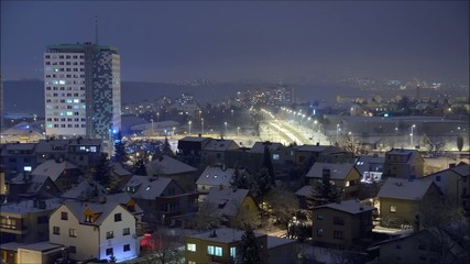 Night city covered by snow in winter
