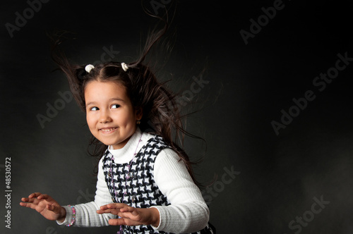charming girl with flying hair and dimples on her cheeks